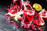 Fresh red juice cocktail with pomegranate seeds and ice