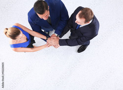 Business team joining hands together, standing , flat lay