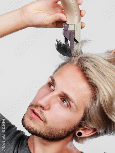 Man going to shave his long hair