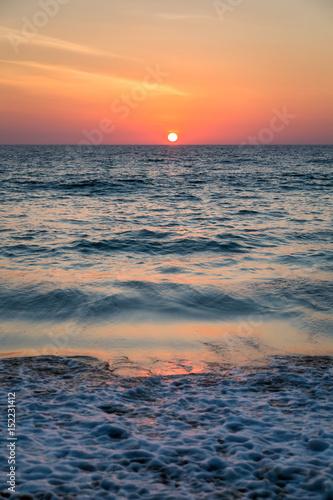 Foto op Canvas Zee zonsondergang Sunset sky on sea