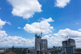 Construction site. Crane and building with blue sky background.