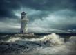 Leinwanddruck Bild - Lighthouse on the sea under sky