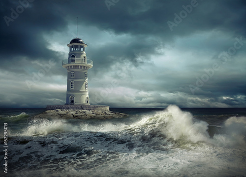 Leinwanddruck Bild Lighthouse on the sea under sky