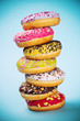 Donuts glazed with sprinkles on light blue background - 152307491