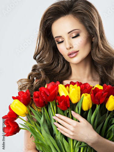 Portrait of calm beautiful young woman with flowers. Slika na platnu