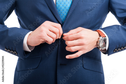 Close-up of man hand clasps a jacket button