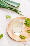 Aloe vera yogurt with fresh leaves on a wooden table