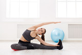 Fototapety Fitness woman at stretching training indoors