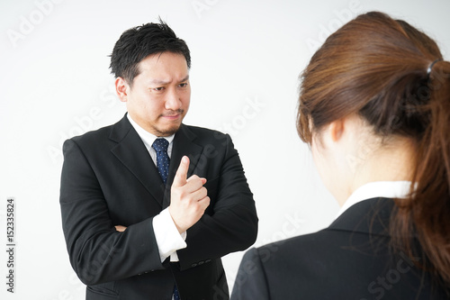 Boss angry with young business person