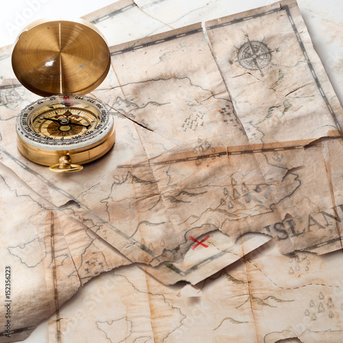Abstract background of mixed grunge vintage fake treasure maps with compass
