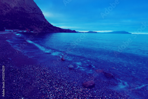 Night sea coast. Scenic seascape background.