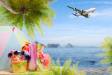 Beach accessory with palm tree and passenger airplane landing above island in tropical sea, concept open travel season background.