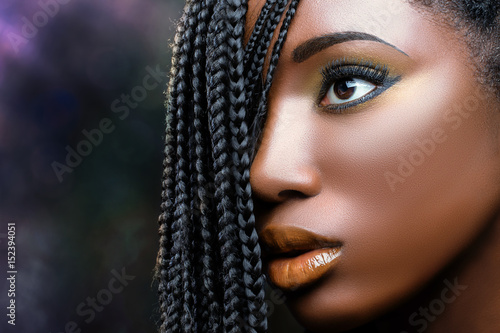 African beauty female face with braids .