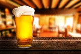 glass of light beer on a table in a pub - 152396470