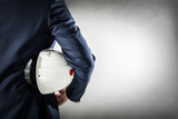 Businessman holding white safety helmet. - 152411458