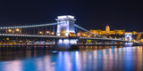 Night view of the Chain Bridge (Lions Bridge) reflected in the Danube river, Budapest city center, Hungary