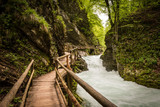 Mountain river and wooden bridge in Vintgar Gorge, Lake Bled natural park, Slovenia