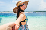 Woman wanting her man to follow her in vacation or honeymoon - 152459624