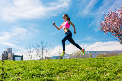 Woman sport running on hill for fitness Poster