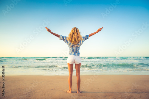 Happy woman having fun on summer vacation