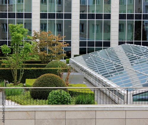 Beautiful roof garden surrounded by glass buildings