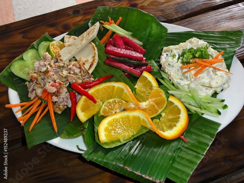 Chamorro- beef kelaguen and potato salad in banana leaves Favorite foods of Chamorros, people from the Northern Mariana Islands. Beef kelaguen  (raw beef cooked only with a marinate