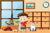 Boy playing toys in room