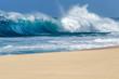 Ocean waves breaking on a sandy beach on the north shore of Oahu Hawaii