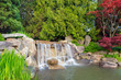 Garden Landscape with Waterfall and Trees - 152549864