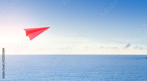 Sea and sky in tourism business concept, 3d rendering of red paper rocket