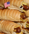 toothpick with the American flag on top of many hotdogs with chi