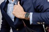 wristwatch on wrist - 152570089