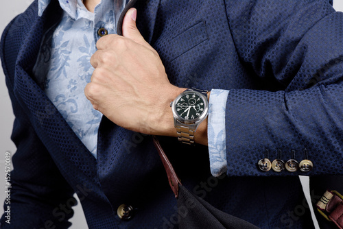 wristwatch on wrist Poster