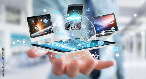 Foto Murales Businessman connecting tech devices to each other 3D rendering