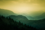 A beautiful sunset landscape of Tatra mountains in Slovakia. Colorful warm spring haze look.