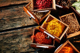 Small wooden drawers filled with assorted spices