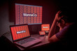 Young Asian male frustrated by WannaCry ransomware attack