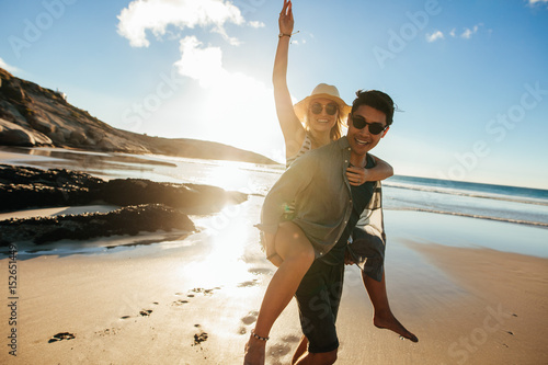 Couple enjoying beach holidays Poster