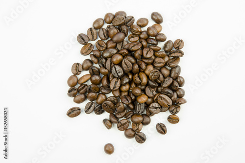 Fotobehang Koffiebonen Still life with close-up view of grains of roasted brown coffee isolated on a white background