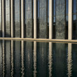 Modern office building by reflecting pool, Minneapolis, Hennepin County, Minnesota, USA