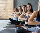 Fototapety Young women in yoga class, relax meditation pose