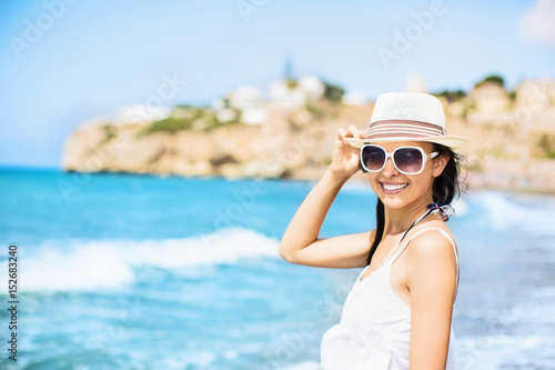 Beautiful girl on the beach at sunset Plakat