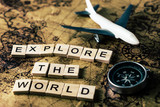 Explore the world concept on vintage map with compass and airplane