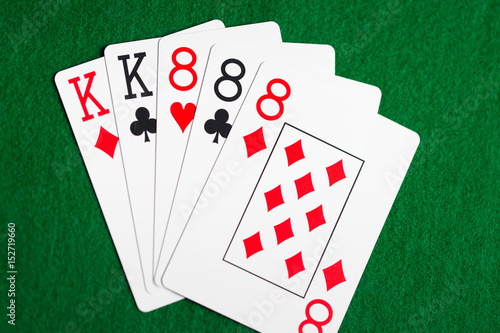 poker hand of playing cards on green casino cloth плакат