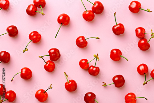 Cherry pattern. Flat lay of cherries on a pink background.Top view - 152722060