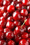 Cherry background. Full frame of fresh ripe cherries. Red background texture.