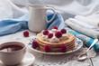 Pancakes with raspberry on a white napkin
