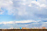 white clouds over view of urban park in Moscow