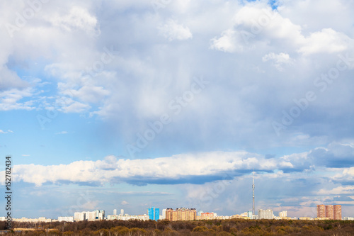 white clouds over view of urban park in Moscow Poster