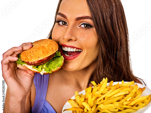 Woman eating french fries and hamburger Poster